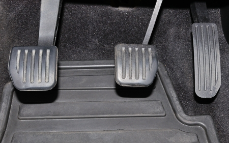 Car pedals (clutch, brake and gas/accelerator) photo