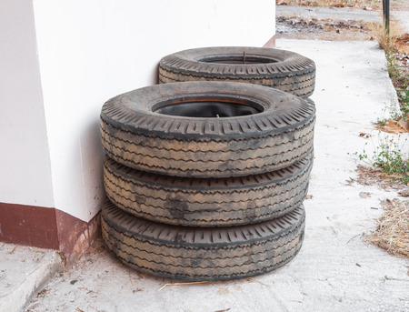 Stack of Truck Tyres on Concrete Ground Imagens
