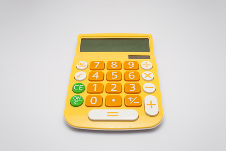 Bright Yellow Calculator with Solar Cell, Isolated Stock Photo