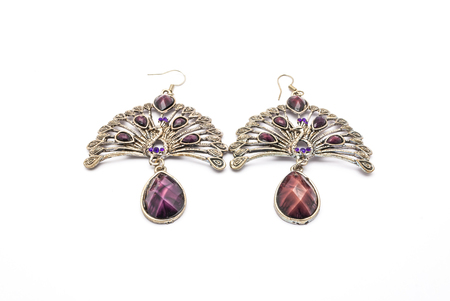Closeup to Pair of Beautiful Peacock Earrings, Isolated