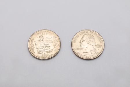 unum: Closeup to Alabama State Symbol on Quarter Dollar Coin on White Background Stock Photo