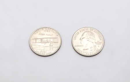 25 cents: Closeup to North Carolina State Symbol on Quarter Dollar Coin on White Background