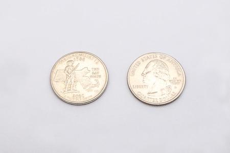 unum: Closeup to Massachusetts State Symbol on Quarter Dollar Coin on White Background