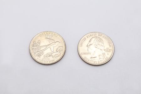 25 cents: Closeup to Oklahoma State Symbol on Quarter Dollar Coin on White Background Stock Photo