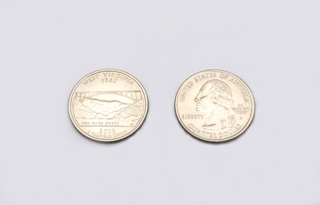 25 cents: Closeup to West Virginia State Symbol on Quarter Dollar Coin on White Background