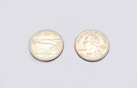 unum: Closeup to West Virginia State Symbol on Quarter Dollar Coin on White Background