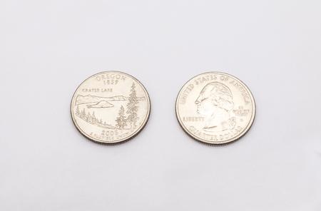 unum: Closeup to Oregon State Symbol on Quarter Dollar Coin on White Background