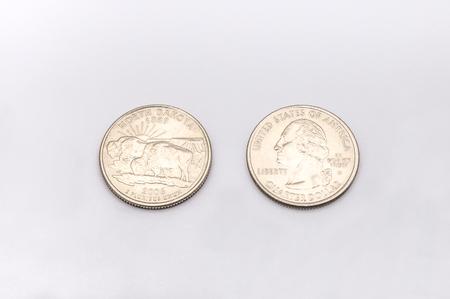 25 cents: Closeup to North Dakota State Symbol on Quarter Dollar Coin on White Background