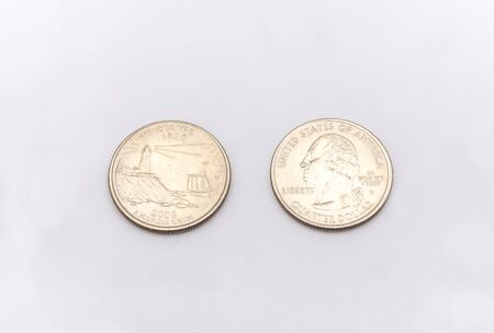 25 cents: Closeup to Maine State Symbol on Quarter Dollar Coin on White Background