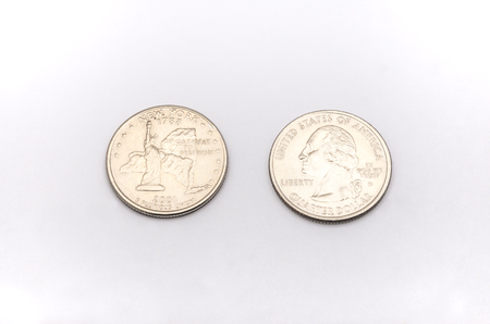 25 cents: Closeup to New York State Symbol on Quarter Dollar Coin on White Background