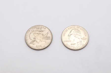 25 cents: Closeup to Louisiana State Symbol on Quarter Dollar Coin on White Background Stock Photo