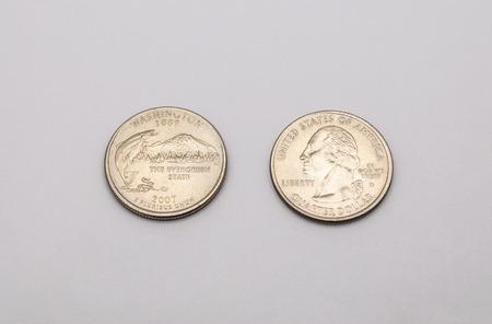25 cents: Closeup to Washington State Symbol on Quarter Dollar Coin on White Background