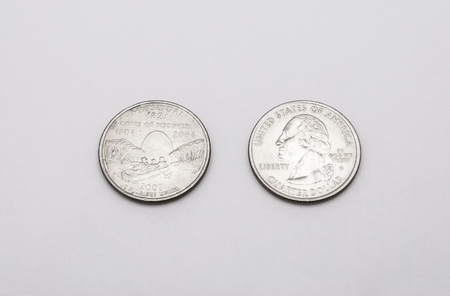 unum: Closeup to Missouri State Symbol on Quarter Dollar Coin on White Background