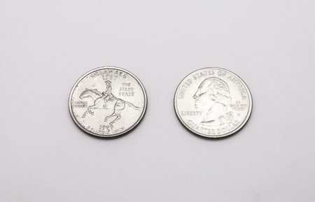 25 cents: Closeup to Delaware State Symbol on Quarter Dollar Coin on White Background