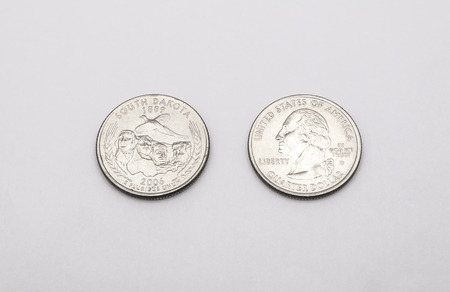 25 cents: Closeup to South Dakota State Symbol on Quarter Dollar Coin on White Background Stock Photo