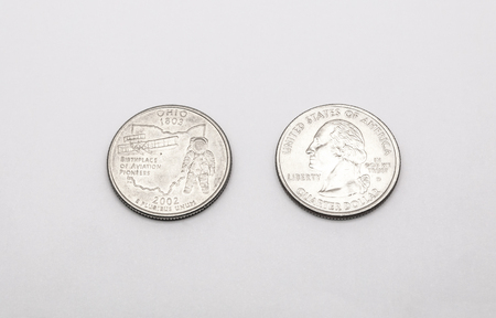25 cents: Closeup to Ohio State Symbol on Quarter Dollar Coin on White Background