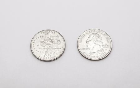 unum: Closeup to Indiana State Symbol on Quarter Dollar Coin on White Background Stock Photo
