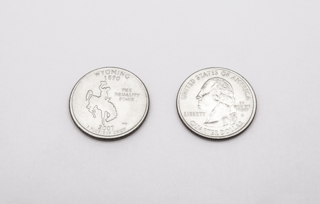 unum: Closeup to Wyoming State Symbol on Quarter Dollar Coin on White Background Stock Photo