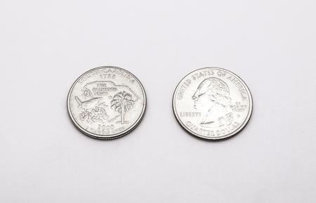 unum: Closeup to South Carolina Symbol on Quarter Dollar Coin on White Background Stock Photo