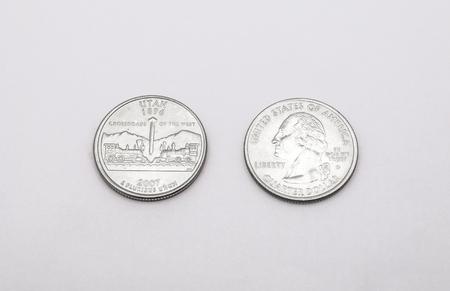 unum: Closeup to Utah State Symbol on Quarter Dollar Coin on White Background Stock Photo
