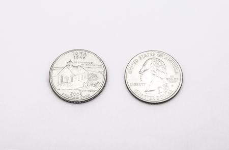 unum: Closeup to Iowa State Symbol on Quarter Dollar Coin on White Background Stock Photo