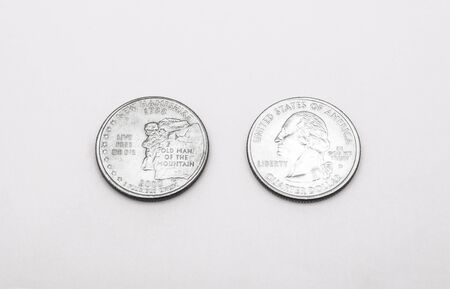 unum: Closeup to New Hampshire State Symbol on Quarter Dollar Coin on White Background