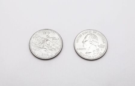 unum: Closeup to Mississippi State Symbol on Quarter Dollar Coin on White Background