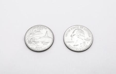 unum: Closeup to Nebraska State Symbol on Quarter Dollar Coin on White Background