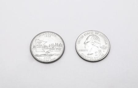 unum: Closeup to Minnesota State Symbol on Quarter Dollar Coin on White Background Stock Photo