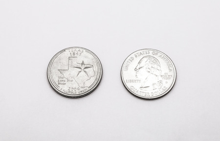 unum: Closeup to Texas State Symbol on Quarter Dollar Coin on White Background Stock Photo