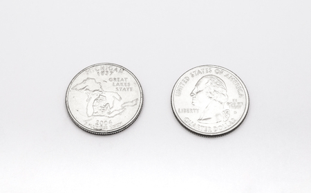 25 cents: Closeup to Michigan State Symbol on Quarter Dollar Coin on White Background