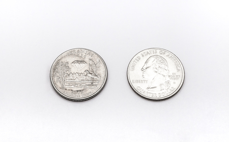 25 cents: Closeup to Arkansas State Symbol on Quarter Dollar Coin on White Background Stock Photo