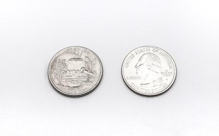 unum: Closeup to Arkansas State Symbol on Quarter Dollar Coin on White Background Stock Photo