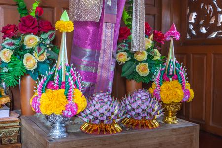 Closeup to Beautiful Thai Rice Offering on Wooden Worship Pedestal Stock Photo