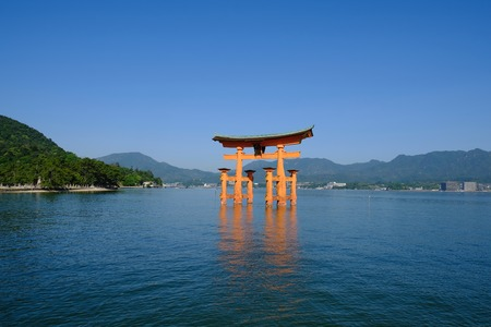 Torii torn in the sea of ??Itsukushima shrine in Hiroshima prefecture of Japan. Stock Photo