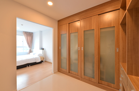 furniture store: wooden carbinets in dressing room in modern home, interior design Stock Photo