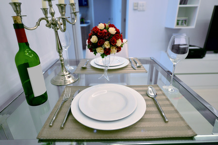 luxury house: dining table with table set in modern home, interior design