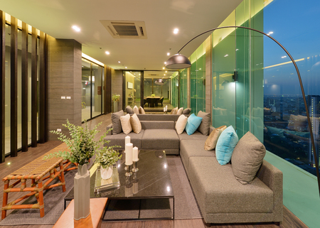 open floor plan: luxury modern living room interior and decoration at night, interior design