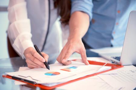 Discussing, writing, estimating business profit plan of company Фото со стока - 93878239