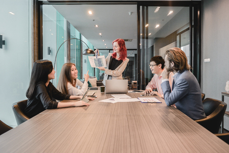 Western business woman boss meeting with her employees in meeting room and sharing ideas, , Multi ethnic