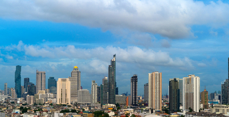 Smart city. Financial district and skyscraper buildings. Bangkok downtown area with blue sky at noon, Thailand.