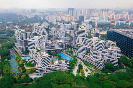 The Interlace apartments in Singapore city and skyscrapers buildings. Modern architecture background. Aerial view