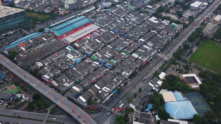 Aerial view of slums. Poor houses and roads in Bangna, Klong Toey in architecture buildings concept, Urban city, Bangkok, Thailand.