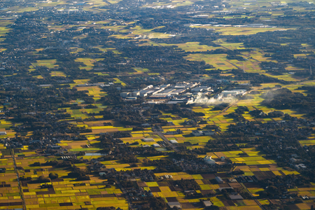 Aerial View of agricultural fields in countryside of Japan in spring season. Rural area. Rice farm pattern natural texture background.
