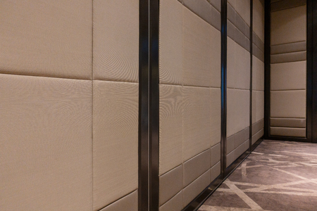 Fabric panels door covered acoustic board pattern surface texture in hotel. Interior material for design decoration background Banco de Imagens