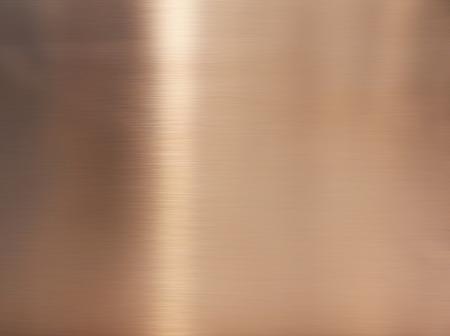 Edelstahl mit goldenem Haaransatz. Glänzende Oberflächenstruktur aus Goldfolie, Bronze oder Kupfermetallmuster. Nahaufnahme des Innenmaterials für Designdekorationshintergrund