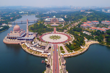 Aerial view of Putra mosque with garden landscape design and Putrajaya Lake, Putrajaya. The most famous tourist attraction in Kuala Lumpur City, Malaysia