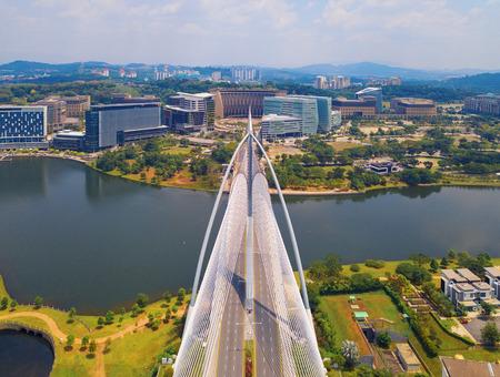Seri Wawasan Bridge or Putra Bridge and Putrajaya Lake with blue sky. The most famous tourist attraction in Kuala Lumpur City, Malaysia