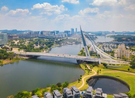 Seri Wawasan Bridge or Putra Bridge and Putrajaya Lake with blue sky. The most famous tourist attraction in Kuala Lumpur City, Malaysia 写真素材