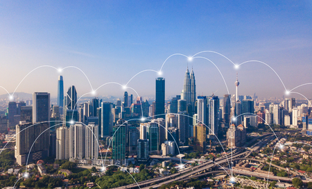 Digital network connection lines of Kuala Lumpur Downtown, Malaysia. Financial district and business centers in smart city in technology concept. Skyscraper and high-rise buildings at noon